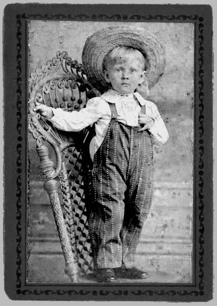 Small boy in bib overalls